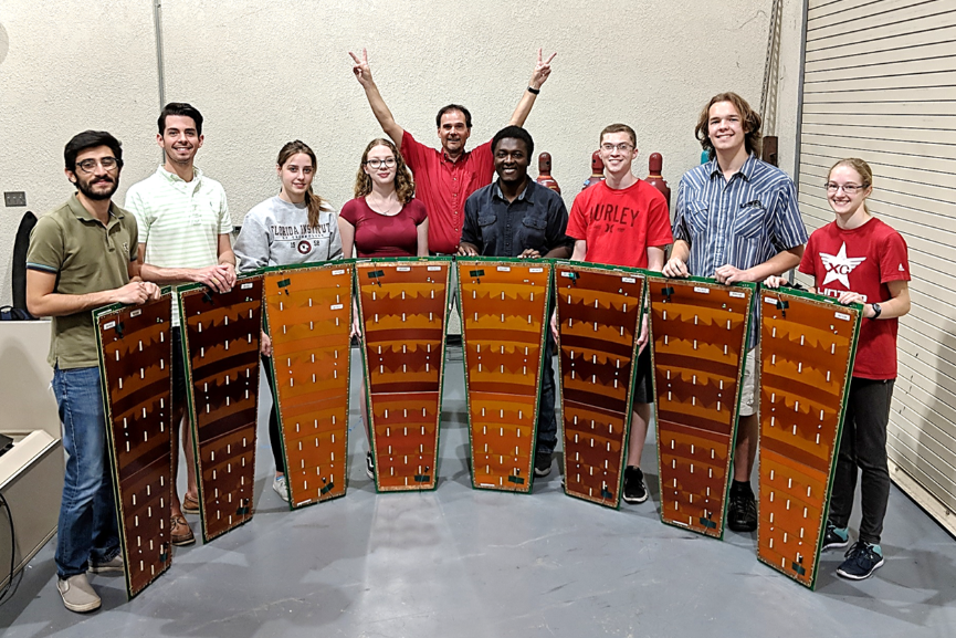 Victory! Successful end of mass production for CMS GE1/1 GEM chambers at FIT. These chambers will be installed in CMS in summer 2019. From left: Mehdi, Stephen, Jacqui, Sarah, Dr. Hohlmann, Jerry, John, Michael, Samantha