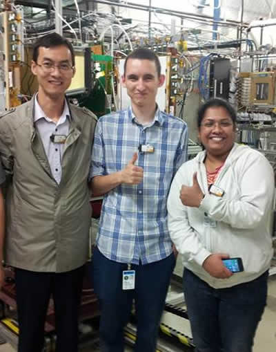 Aiwu, Jessie, and Vallary after installing large GEMs in Fermilab beam